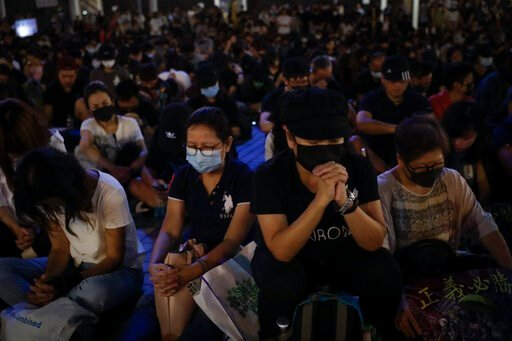 (AP Photo/Mark Schiefelbein). Protesters attend a prayer rally at Edinburgh Place in Hong Kong, Saturday, Oct. 19, 2019. Hong Kong pro-democracy protesters are set for another weekend of civil disobedience as they prepare to hold an unauthorized protes...