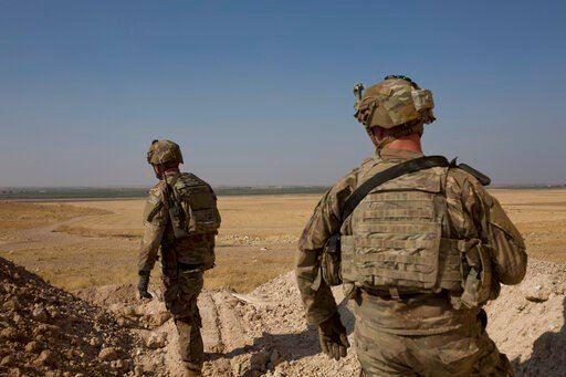(AP Photo/Maya Alleruzzo, File). FILE - In this Sept. 6, 2019 file photo, U.S. soldiers survey the the safe zone between Syria and the Turkish border near Tal Abyad, Syria, on a joint patrol with the Tax Abyad Military Council, affiliated with the U.S....