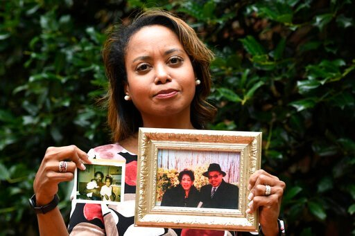 (AP Photo/Susan Walsh). In this Sept. 6, 2019, photo, Donna Cryer holds up family photos that include her father Roland Henry, as she poses for a photo in Washington. When her father died, she tried to donate his organs, yet the local organ collection ...