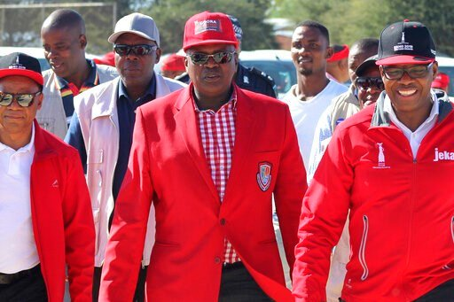 (AP Photo/Sello Motseta). In this April 5, 2019, photo, Botswana's President Mokgweetsi Masisi, center, is photographed at a rally in Gaborone, Botswana. The country's ruling party, the BDF (Botswana Democratic Party) faces the tightest election of its...