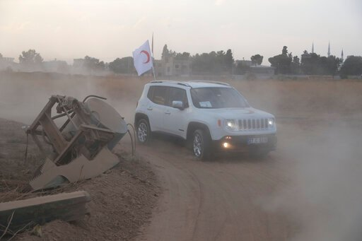 (Fatih Isci/Turkish Red Crescent via AP). In this image provided by Turkish Red Crescent, Turkish Red Crescent vehicles arrive to deliver aid to Syrians in Ras Al-Ayn, Syria, Saturday, Oct. 19, 2019. Turkish Red Crescent says it has delivered humanitar...