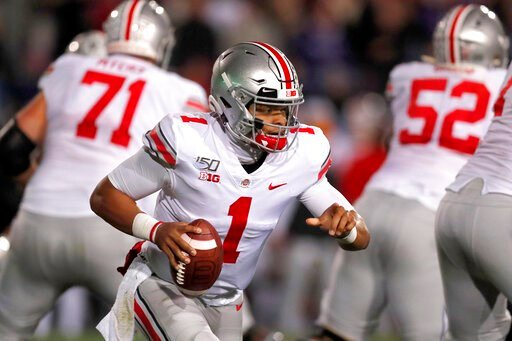 (AP Photo/Charles Rex Arbogast). Ohio State quarterback Justin Fields (1) scrambles during the first half of an NCAA college football game against  Northwestern, Friday, Oct. 18, 2019, in Evanston, Ill.