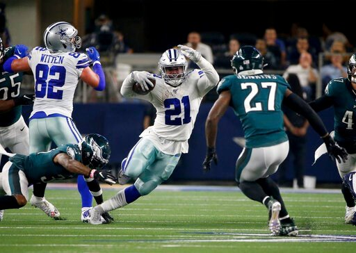 (AP Photo/Ron Jenkins). Dallas Cowboys tight end Jason Witten (82) blocks for running back Ezekiel Elliott (21) as Philadelphia Eagles strong safety Malcolm Jenkins (27) attempts to make the stop in the first half of an NFL football game in Arlington, ...