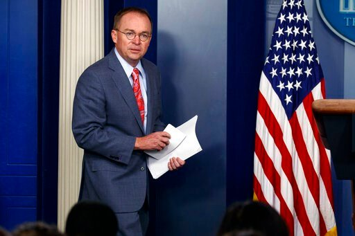 """(AP Photo/Evan Vucci, File). FILE - In this Thursday, Oct. 17, 2019, file photo, White House chief of staff Mick Mulvaney arrives to a news conference, in Washington. On Sunday, Oct. 20, on """"Fox News Sunday,"""" after acknowledging the Trump administratio..."""