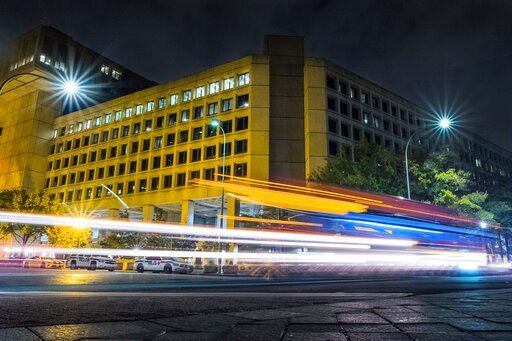 (AP Photo/J. David Ake, File). FILE - In this Nov. 1, 2017, file photo, traffic along Pennsylvania Avenue in Washington streaks past the Federal Bureau of Investigation headquarters building. Federal policies emphasizing privacy over disclosure and a c...