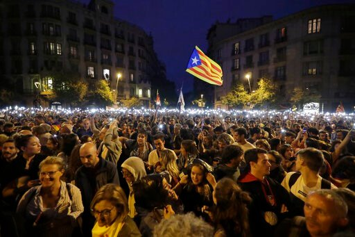 (AP Photo/Ben Curtis). People hold up their phones with the torches switched on during a Catalan pro-independence protest in Barcelona, Spain, Sunday, Oct. 20, 2019. Barcelona and the rest of the restive Spanish region of Catalonia are reeling from sev...