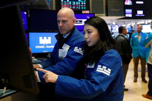 (AP Photo/Richard Drew). Specialists Mark Fitzgerald and Lingbo Jiang work at the post that handles Teva and Cardinal Health on the floor of the New York Stock Exchange, Monday, Oct. 21, 2019. Stocks are opening higher on Wall Street Monday as investor...