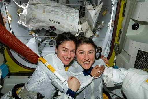 (NASA via AP). In this photo released by NASA on Friday, Oct. 18, 2019, U.S. astronauts Jessica Meir, left, and Christina Koch pose for a photo in the International Space Station. The astronauts who took part in the first all-female spacewalk are still...