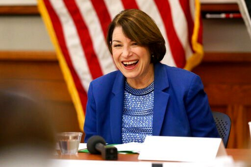 (Eileen Meslar/Telegraph Herald via AP). Presidential candidate U.S. Sen. Amy Klobuchar, D-MN., laughs during her roundtable with veterans at Carnegie-Stout Public Library in Dubuque on Saturday, Oct. 19, 2019.
