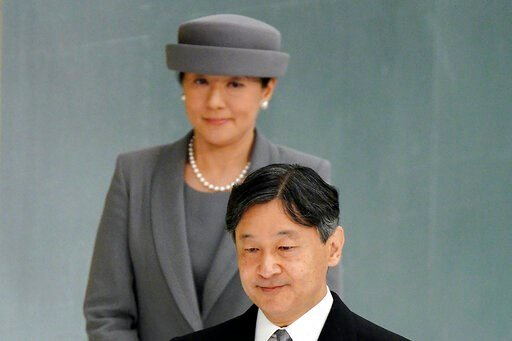 (AP Photo/Eugene Hoshiko, File). FILE - In this Aug. 15, 2019, file photo, Japanese Emperor Naruhito, accompanied by Empress Masako, walks to deliver his remarks during a memorial ceremony for the war dead at Nippon Budokan Martial Arts Hall in Tokyo.
