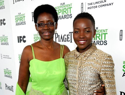 (Photo by Jordan Strauss/Invision/AP, File). FILE - This March 1, 2014, file photo shows Dorothy Nyong'o, left, with her daughter actress Lupita Nyong'o, at the 2014 Film Independent Spirit Awards in Santa Monica, Calif.