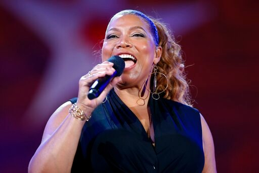 (AP Photo/Michael Dwyer, File). FILE - In this Wednesday, July 3, 2019, file photo, Queen Latifah performs during the dress rehearsal for the Boston Pops Fireworks Spectacular in Boston. Harvard is set to award the W.E.B. Du Bois Medal to Queen Latifah...