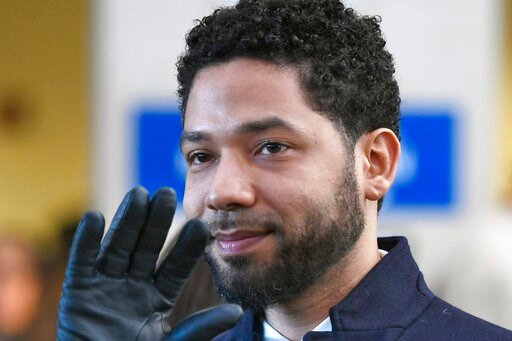 (AP Photo/Paul Beaty, File). FILE - In this March 26, 2019 file photo, actor Jussie Smollett smiles and waves to supporters before leaving Cook County Court after his charges were dropped in Chicago. A decision is expected on a motion in federal court ...