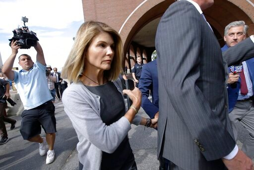 (AP Photo/Steven Senne, File). FILE - In this Aug. 27, 2019 file photo, actress Lori Loughlin departs federal court in Boston after a hearing in a nationwide college admissions bribery scandal.  Loughlin, her fashion designer husband, Mossimo Giannulli...