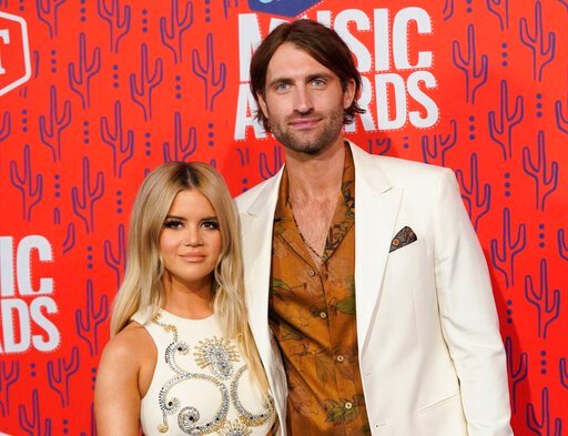 (AP Photo/Sanford Myers, File). FILE - This June 5, 2019 file photo shows Maren Morris and Ryan Hurd at the CMT Music Awards in Nashville, Tenn. The Grammy-winning country singer posted of a photo of herself with her husband Hurd on Instagram on Tuesda...