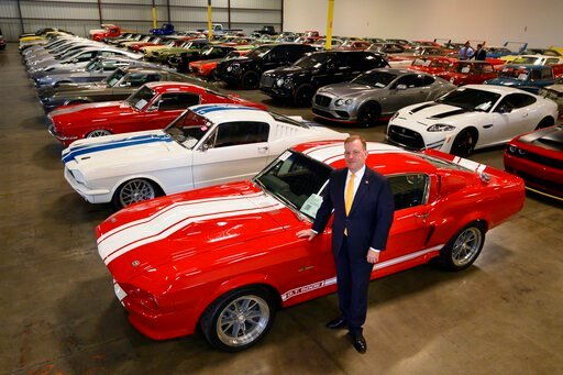 (Randy Pench/The Sacramento Bee via AP). FILE - In this Sept. 16, 2019 photo, McGregor Scott, U.S. Attorney for the Eastern District of California, stands next to a 1967 Ford Shelby GT 500, that was seized along with other cars by the federal governmen...