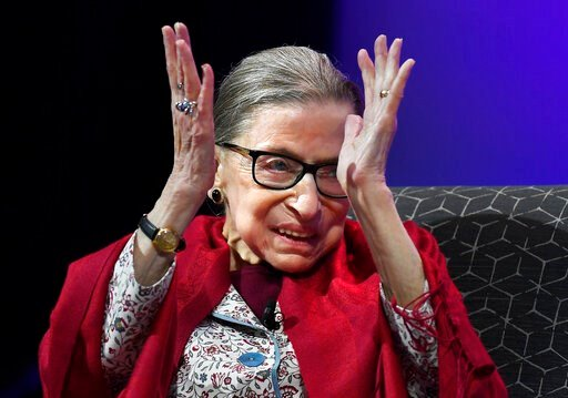 (AP Photo/Jessica Hill). In this Oct. 3, 2019 photo, U.S. Supreme Court Justice Ruth Bader Ginsburg claps after listening to students sing opera at Amherst College in Amherst, Mass.  Supreme Court Justice Ruth Bader Ginsburg is the winner of this year'...