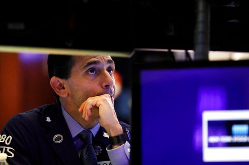 (AP Photo/Richard Drew, File). FILE - In this Oct. 2, 2019, file photo specialist Peter Mazza works on the floor of the New York Stock Exchange. The U.S. stock market opens at 9:30 a.m. EDT on Wednesday, Oct. 23.