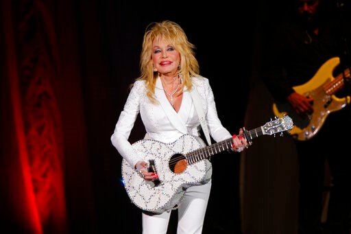 """(Photo by Wade Payne/Invision/AP, File). FILE - In this July 31, 2015 file photo, Dolly Parton performs in concert at the Ryman Auditorium in Nashville, Tenn. Parton will perform a new song """"Faith"""" in a gospel medley at the Country Music Association Aw..."""