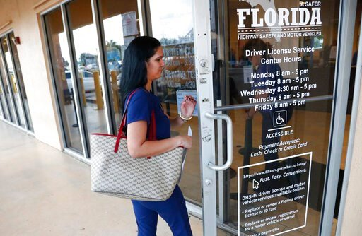 (AP Photo/Wilfredo Lee). A woman enters a Florida Highway Safety and Motor Vehicles drivers license service center, Tuesday, Oct. 8, 2019, in Hialeah, Fla. The U.S. Census Bureau has asked the 50 states for drivers' license information, months after Pr...