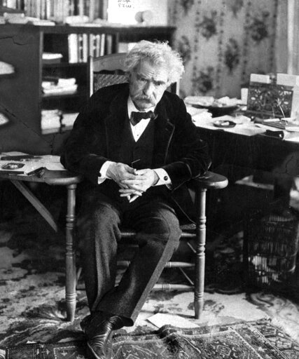 """(AP Photo, File). FILE - This undated photo shows Mark Twain, whose adventures overseas, and the irreverent book which helped make him famous, will be featured in an upcoming exhibit at the New-York Historical Society.""""Mark Twain and the Holy Land"""" ope..."""