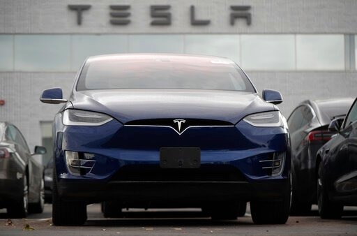 (AP Photo/David Zalubowski). In this Sunday, Oct. 20, 2019, photo an unsold 2019 Model X sits under a sign at a Tesla dealership in Littleton, Colo. Tesla reports financial earns on Wednesday, Oct. 23.