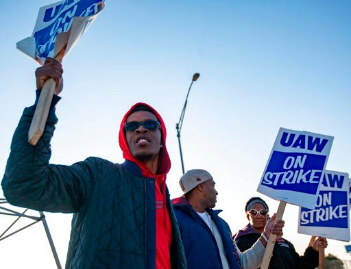 (Troy Stolt/St. Louis Post-Dispatch via AP). Motorline worker Ray Gladney of Florrisant, materials worker Brookes Robinson of Central West End, and Trim Doorline Worker Danielle Harris of Richmond Heights, picket at the General Motors plant in Wentzvil...