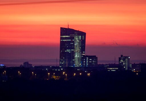 (AP Photo/Michael Probst). The sky is orange over the European central Bank in Frankfurt, Germany, before sunrise on Tuesday, Oct. 22, 2019.
