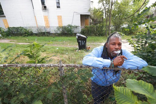 "(AP Photo/Charles Rex Arbogast). Willie ""J.R."" Fleming, director of the Chicago Anti-Eviction Campaign and who helped organize a nonprofit called Hemp in the Hood smokes his medicinal marijuana cigarette in a vacant lot next to a boarded up home on the..."