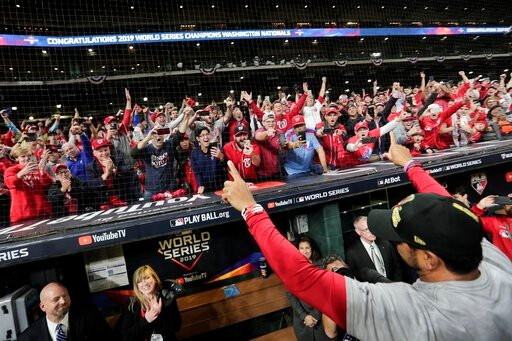 (AP Photo/David J. Phillip). Washington Nationals manager Dave Martinez waves to the fans after Game 7 of the baseball World Series against the Houston Astros Wednesday, Oct. 30, 2019, in Houston. The Nationals won 6-2 to win the series.
