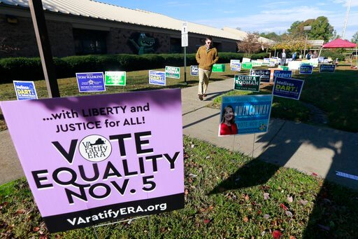 (AP Photo/Steve Helber). Voters walk through a sea of campaign signs at a polling station in Richmond, Va., Tuesday, Nov. 5, 2019. All seats in the Virginia House of Delegates and State senate are up for election.