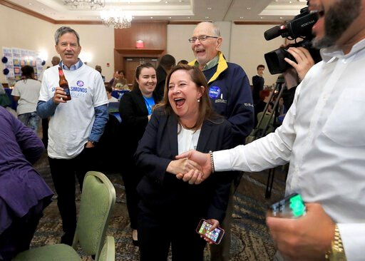 (Rob Ostermaier/The Virginian-Pilot via AP). Candidate for the 94th District, Shelly Simonds, celebrates with supporters as election results begin to come in Tuesday, Nov. 5, 2019, at the Marriott in Newport News, Va.