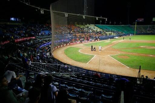 (AP Photo/Ariana Cubillos). The stadium is partially empty during the opening winter season game between Los Leones de Caracas and Los Tigres de Aragua in Caracas, Venezuela, Tuesday, Nov. 5, 2019. A deepening crisis has left her nation in shambles, an...