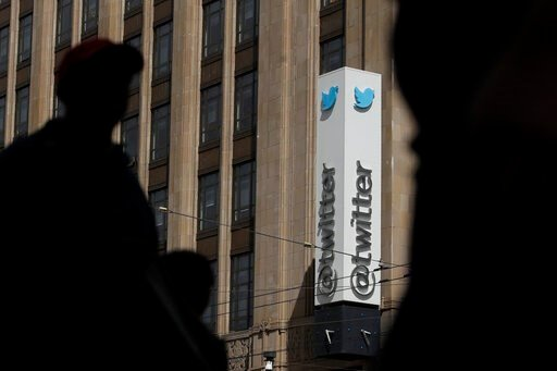 (AP Photo/Jeff Chiu, File). FILE - This July 9, 2019, file photo shows pedestrians walking across the street from the Twitter office building in San Francisco. The Saudi government recruited two Twitter employees to get personal account information of ...