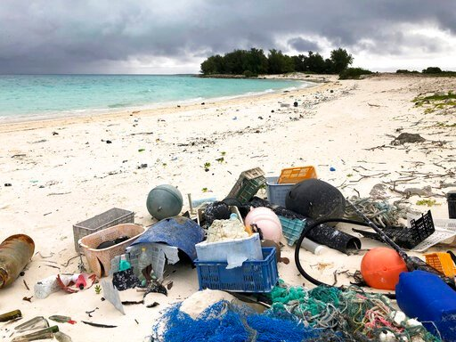(AP Photo/Caleb Jones). In this Oct. 22, 2019, photo, plastic and other marine debris sits on the beach on Midway Atoll in the Northwestern Hawaiian Islands. In one of the most remote places on Earth, Midway Atoll is a wildlife sanctuary that should be...