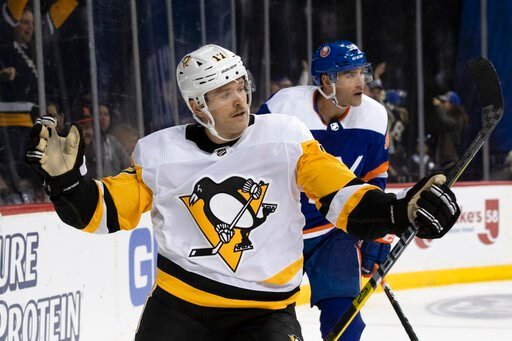 (AP Photo/Mary Altaffer). Pittsburgh Penguins right wing Bryan Rust celebrates after scoring a goal against the New York Islanders during the third period of an NHL hockey game, Thursday, Nov. 7, 2019, in New York. The Penguins won 4-3.