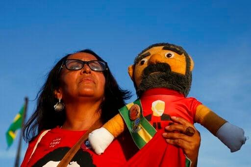 (AP Photo/Eraldo Peres). A supporter holds a doll depicting jailed former President Luiz Inacio Lula da Silva, outside Brazil'sSupreme Court in Brasilia, Brazil, Thursday, Nov. 7, 2019. The Supreme Court will resume debate over if it's legal (as is don...