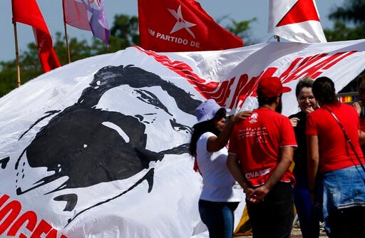 (AP Photo/Eraldo Peres). Workers' Party members gather to show support for Brazil's jailed, former President Luiz Inacio Lula da Silva, outside the Supreme Court in Brasilia, Brazil, Thursday, Nov. 7, 2019. Judges are debating whether a defendant is to...