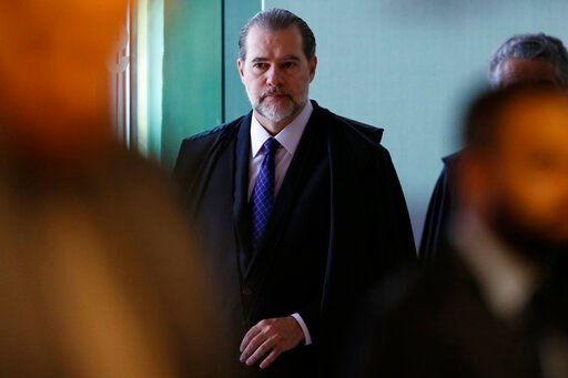 (AP Photo/Eraldo Peres). President of Brazil's Federal Supreme Court Dias Toffoli arrives for the debate on whether a defendant is to begin serving his sentence after a conviction has been reached by the first appellate court, in Brasilia, Brazil, Thur...