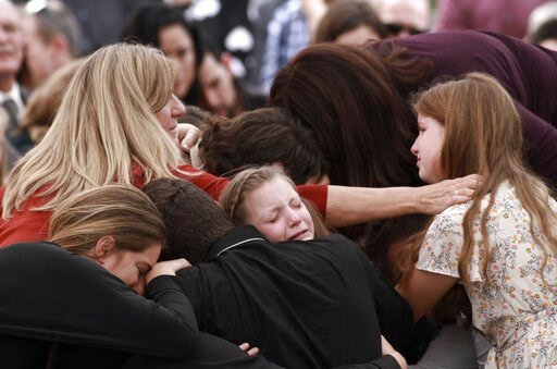 (AP Photo/Christian Chavez). Family and friends weep during the funeral service for Dawna Ray Langford, 43, and her sons Trevor, 11, and Rogan, 2, who were killed in an ambush earlier this week, in La Mora, Mexico, Thursday, Nov. 7, 2019. As Mexican so...