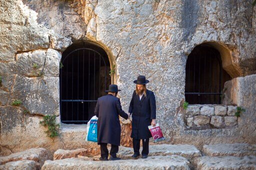 (AP Photo/Ariel Schalit). In this Thursday, Oct. 31, 2019 photo, ultra-Orthodox Jews visits the Tomb of the Kings, a large underground burial complex dating to the first century BC, in east Jerusalem neighborhood of Sheikh Jarrah. After several aborted...