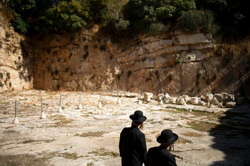(AP Photo/Ariel Schalit). In this Thursday, Oct. 31, 2019 photo, ultra-Orthodox Jews visit the Tomb of the Kings, a large underground burial complex dating to the first century BC, in east Jerusalem neighborhood of Sheikh Jarrah. After several aborted ...