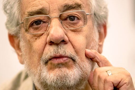 "(AP Photo/Bernat Armangue, File). FILE - In this July 12, 2019, photo, Placido Domingo speaks during a news conference about his upcoming show ""Giovanna d'Arco"" in Madrid, Spain. The Tokyo Olympics organizing committee says opera legend Domingo has sai..."