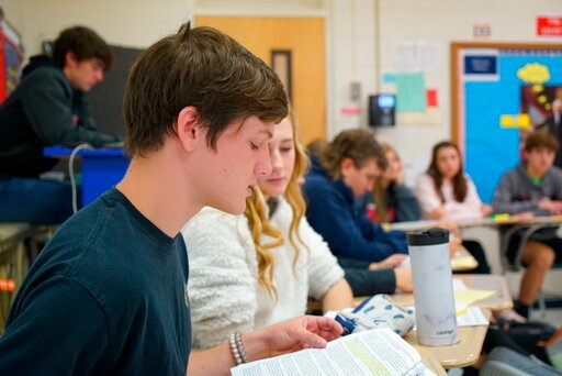 (AP Photo/Allen G. Breed). Tenth-grader Landon Hackney makes an argument during civics class at Chatham Central High School in Bear Creek, N.C., on Tuesday, Nov. 5, 2019. The class is debating whether President Trump should be impeached. The House impe...