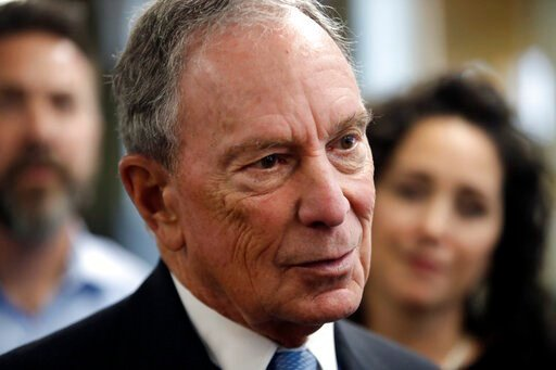 (AP Photo/Elise Amendola, File). FILE - In this Jan. 29, 2019 file photo, potential Democratic presidential candidate Michael Bloomberg speaks to workers during a tour of the WH Bagshaw Company, a pin and precision component manufacturer, in Nashua, N....