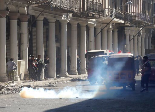 (AP Photo/Hadi Mizban). Iraqi riot police fire tear gas to disperse anti-government protesters during ongoing protests in Baghdad, Iraq, Friday, Nov. 8, 2019. Iraqi security and medical officials say the country's main port closed again after brief res...