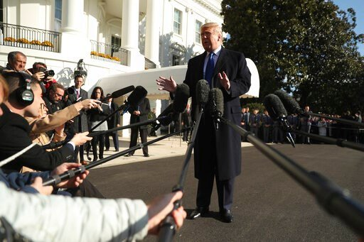 (AP Photo/Andrew Harnik). President Donald Trump speaks to reporters on the South Lawn of the White House in Washington, Friday, Nov. 8, 2019, before boarding Marine One for a short trip to Andrews Air Force Base, Md. and then on to Georgia to meet wit...