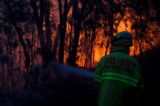 (Dan Himbrechts/AAP Image via AP). Fire and Rescue NSW firefighters conduct property protection as a bushfire burns close to homes on Railway Parade in Woodford NSW, Friday, Nov. 8, 2019. Firefighters battled 90 fires across Australia's most populous s...