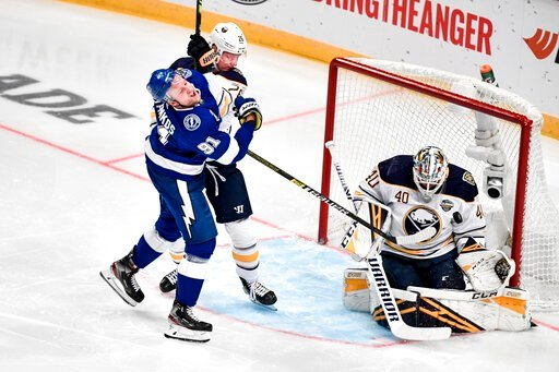 ( Jessica Gow/TT News Agency via AP). Tampa's Steven Stamkos tries to score past Buffalo's Rasmus Dahlin and goalie Carter Hutton during a NHL Global Series hockey match between the Buffalo Sabres and Tampa Bay Lightning at the Globen Arena, in Stockho...