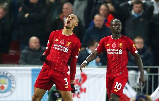 (AP Photo/Jon Super). Liverpool's Fabinho celebrates after scoring his side's opening goal during the English Premier League soccer match between Liverpool and Manchester City at Anfield stadium in Liverpool, England, Sunday, Nov. 10, 2019.